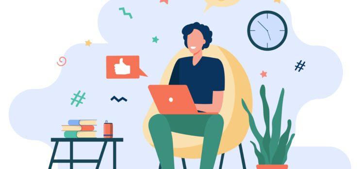Mann sitzt in Sessel und arbeitet von zuhause am Laptop